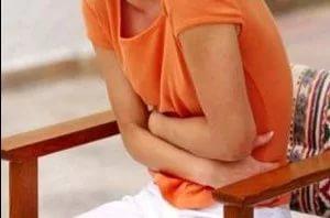 Тянущая боль внизу живота у женщин: причины, симптомы, лечение